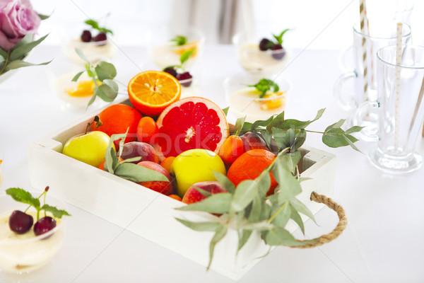 Candy bar with cake, tiramisu, panna cotta and citrus. Birthday  Stock photo © dashapetrenko