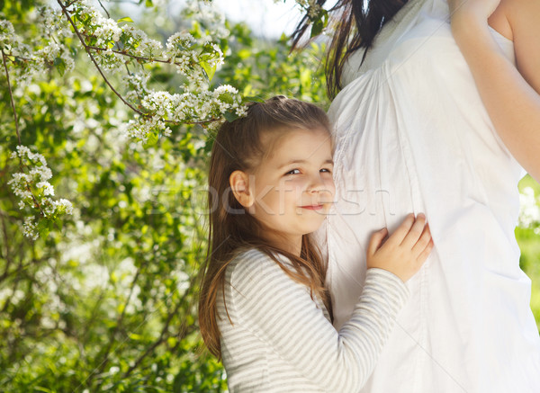 Happy pregnant mother and her little daughter  Stock photo © dashapetrenko