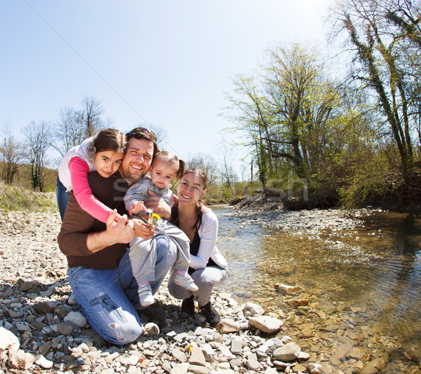 Happy young family with two little daughters near the mountain r Stock photo © dashapetrenko