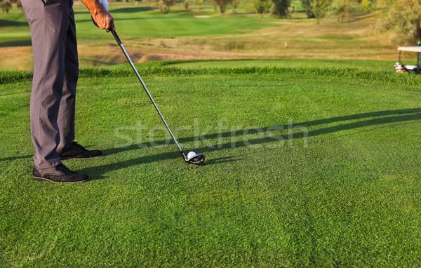 Golfer putting, selective focus on golf ball Stock photo © dashapetrenko