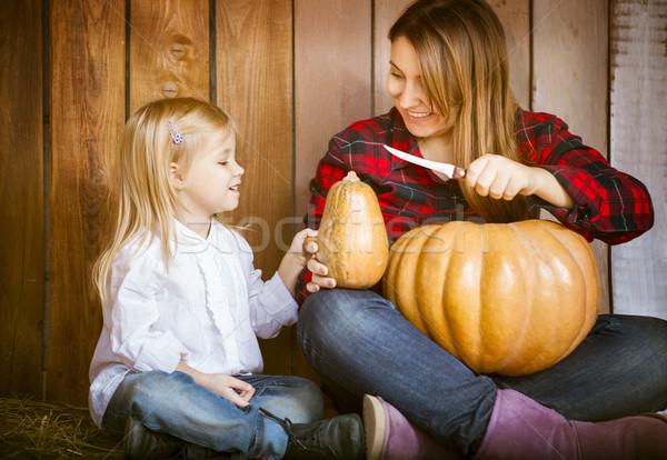 Mother and daughter carving pumpkins Stock photo © dashapetrenko