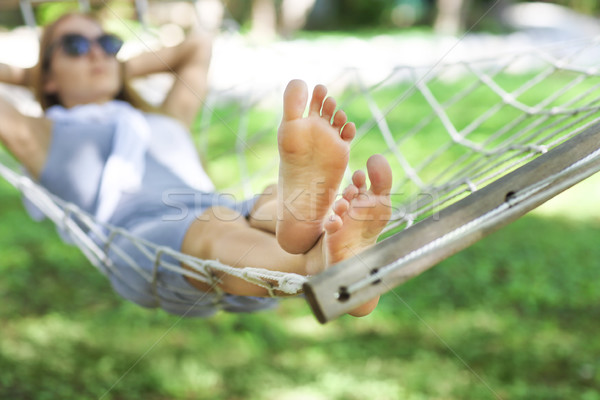 Lazy time. Woman in a hammock  Stock photo © dashapetrenko