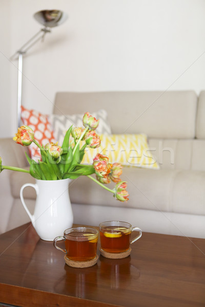 Beautiful orange tulips bouquet on wooden table in the living ro Stock photo © dashapetrenko