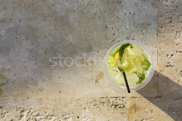 Limonata cam taş buz gözlük içmek Stok fotoğraf © dashapetrenko