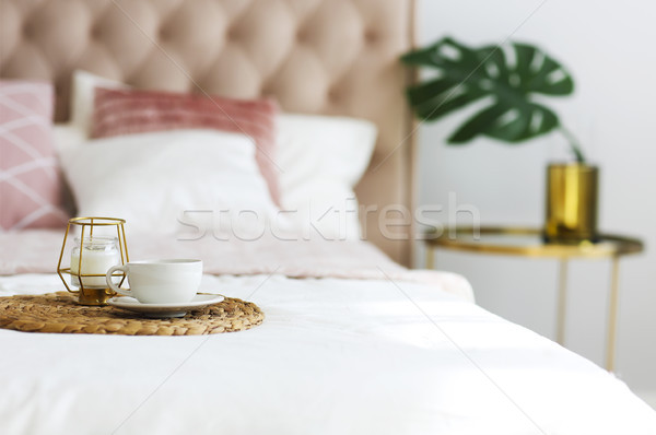 Modern bedroom with table side and pillows on the bed Stock photo © dashapetrenko