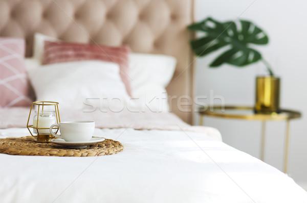 Modern hálószoba asztal oldal párnák ágy Stock fotó © dashapetrenko