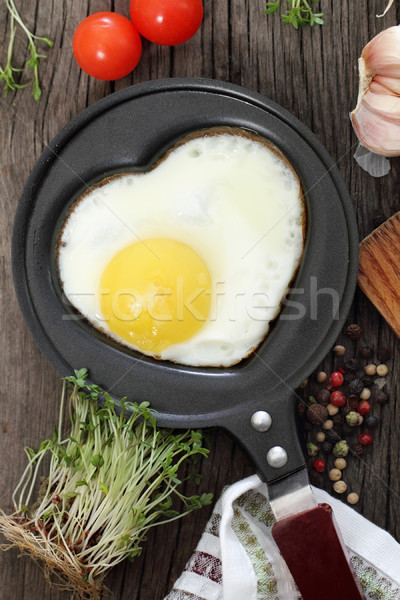 Breakfast with fried egg in heart-shaped form  Stock photo © dashapetrenko