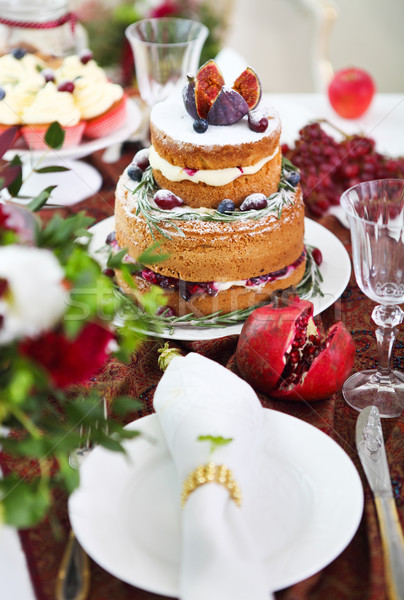 Stock photo: Dessert table for a party. Cake, cupcakes, sweetness and flowers