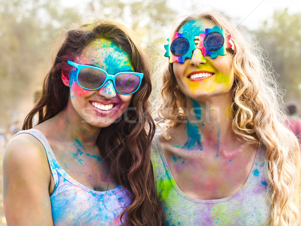 Portrait of happy girls on holi color festival Stock photo © dashapetrenko