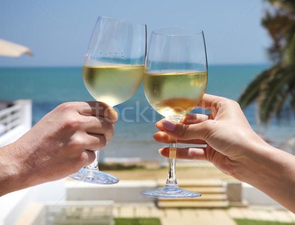 Man and woman clanging wine glasses with white wine  Stock photo © dashapetrenko
