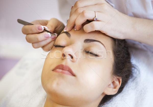 Beautiful young woman in cosmetic salon Stock photo © dashapetrenko