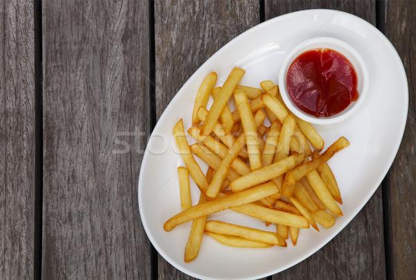 Patatine fritte ketchup bianco piatto legno texture Foto d'archivio © dashapetrenko