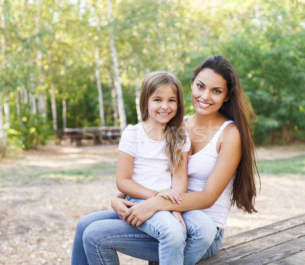 Mother and daughter in the summer park Stock photo © dashapetrenko