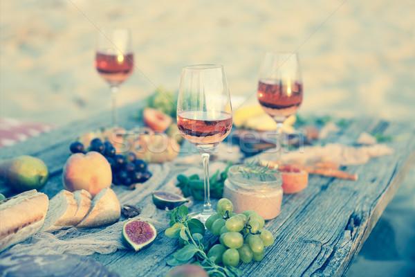 Felső kilátás tengerpart piknik asztal buli étel Stock fotó © dashapetrenko