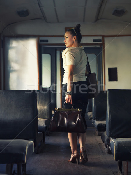 Woman with a suitcase walking in wagon  Stock photo © dashapetrenko