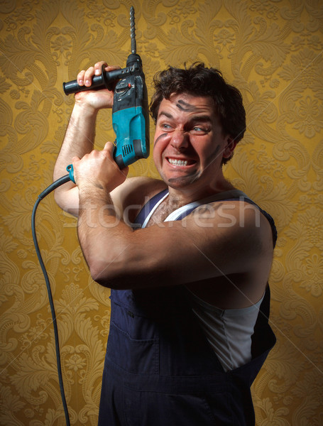The builder holds the professional puncher-hammer Stock photo © dashapetrenko