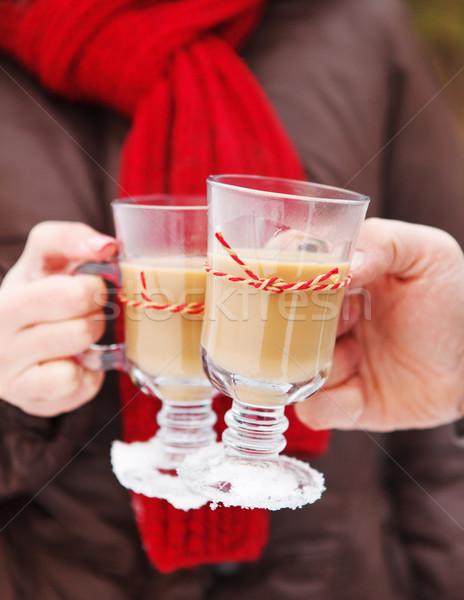 Couple holding cups of hot chocolate outdoors Stock photo © dashapetrenko