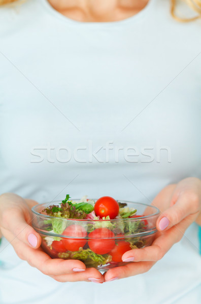Woman diet concept portrait. Female model eating green salad Stock photo © dashapetrenko