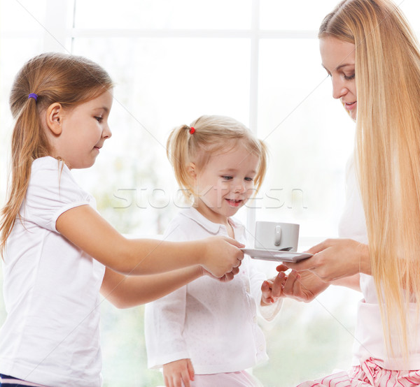 Mother and daughters playing in the bedroom in the Mother's Day Stock photo © dashapetrenko