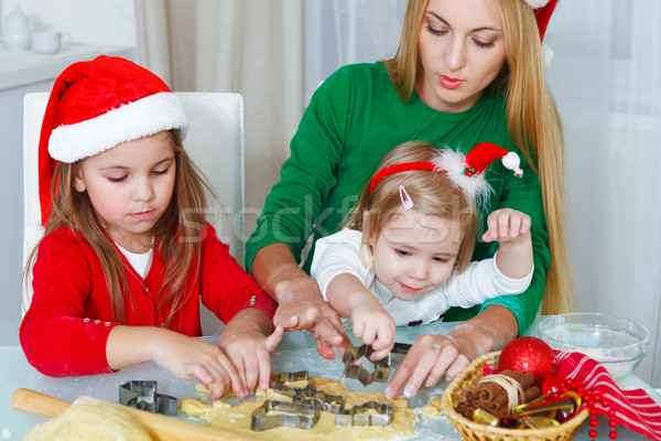 Two little girls with mother baking Christmas cookies Stock photo © dashapetrenko