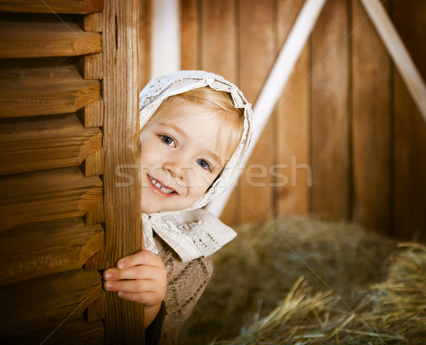 Stock photo: Vintage styled photo of little girl in farm