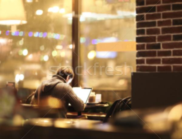 Blurred man with laptop at cafe background Stock photo © dashapetrenko