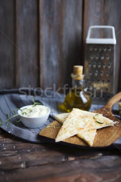 Focaccia with olive oil, cheese, white sause and herbs Stock photo © dashapetrenko