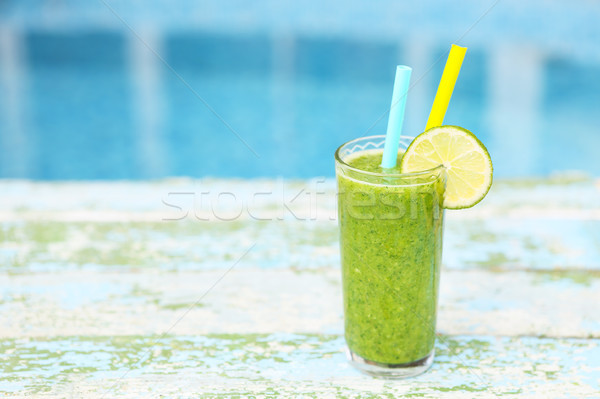 Freshly blended green fruit smoothie in glass with straw Stock photo © dashapetrenko
