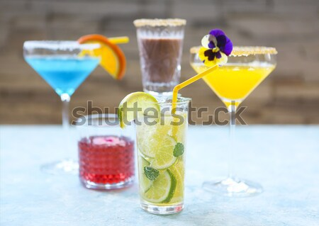 Different cold refreshing cocktails on the table Stock photo © dashapetrenko