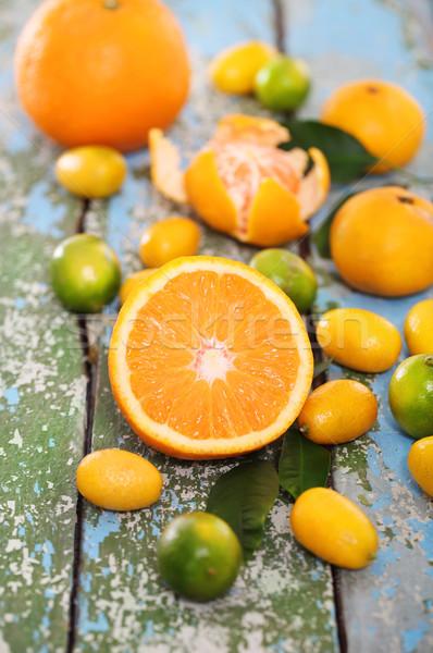 Fresh citrus fruits on the wooden table Stock photo © dashapetrenko