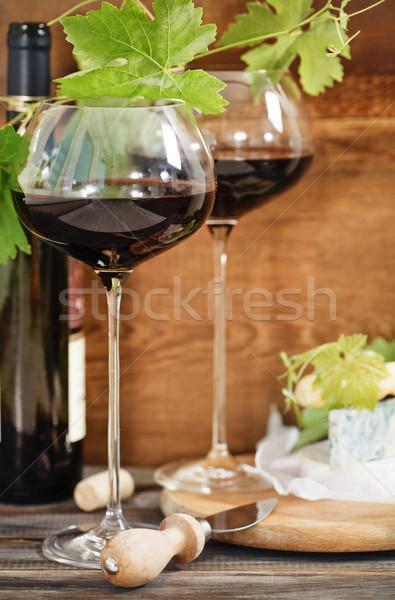 Still life with red wine and chesse Stock photo © dashapetrenko