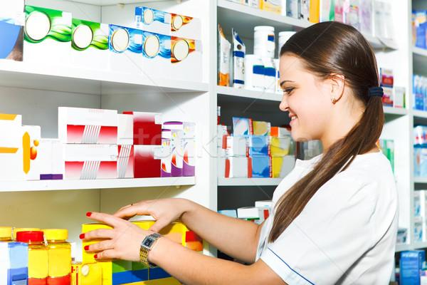 Female pharmacist at the drugstore Stock photo © dashapetrenko