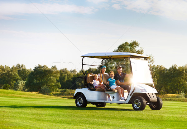 Beautiful family portrait in a cart at the golf course Stock photo © dashapetrenko