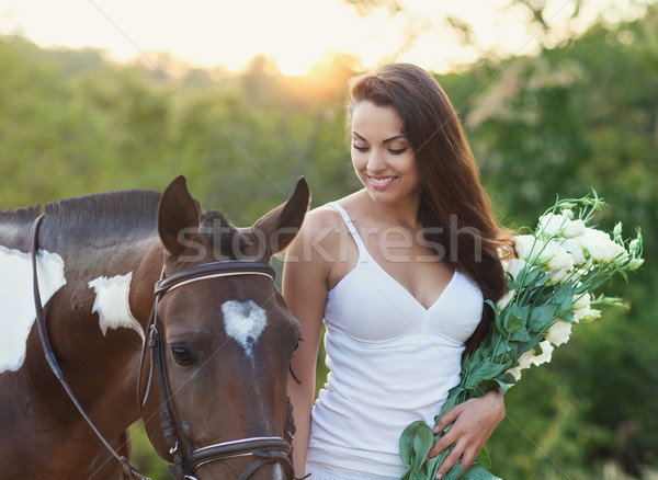 Stock photo: Beautiful woman and a horse