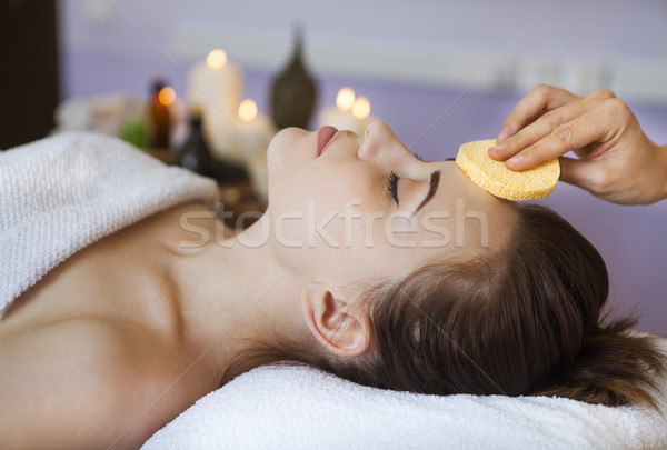 Relaxed woman with a deep cleansing nourishing face mask applied Stock photo © dashapetrenko
