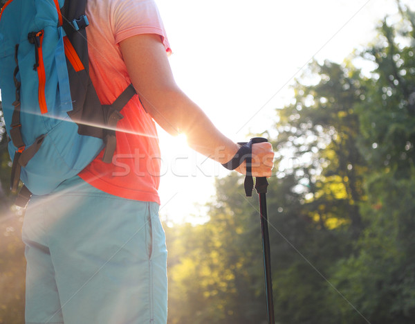Man hiking with backpac and sticks in mountains Stock photo © dashapetrenko