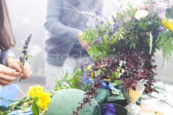 Woman decorating flower bouquet Stock photo © dashapetrenko