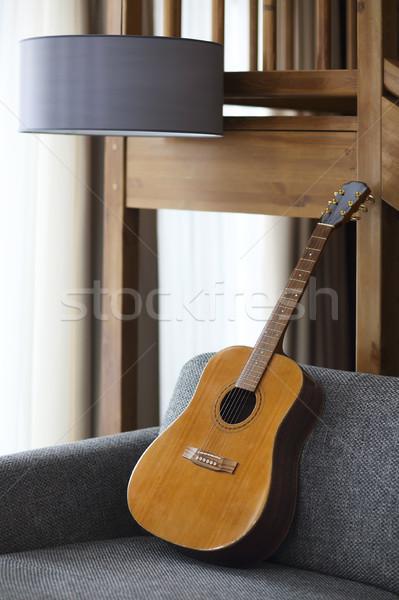 гостиной гитаре диван домой фон Сток-фото © dashapetrenko