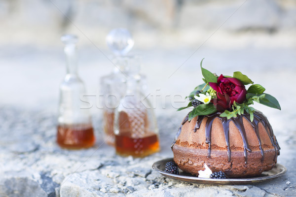 Cocolate cake and three whiskey decanters  Stock photo © dashapetrenko