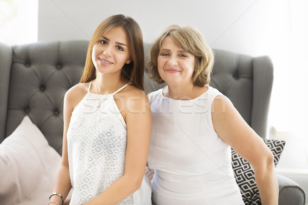 Mature woman embrace with young teen girl Stock photo © dashapetrenko