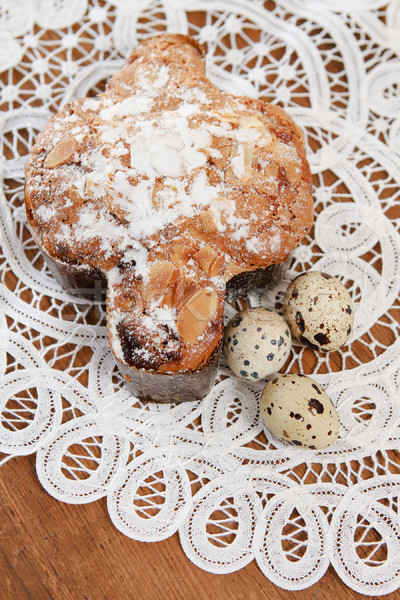 Spotted eggs and easter pie on wooden  Stock photo © dashapetrenko