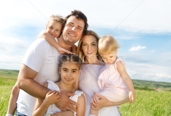 Happy young family with three children Stock photo © dashapetrenko