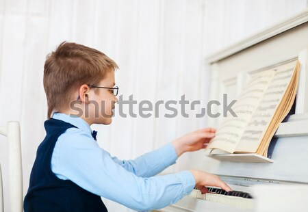 Little boy playing piano at home Stock photo © dashapetrenko