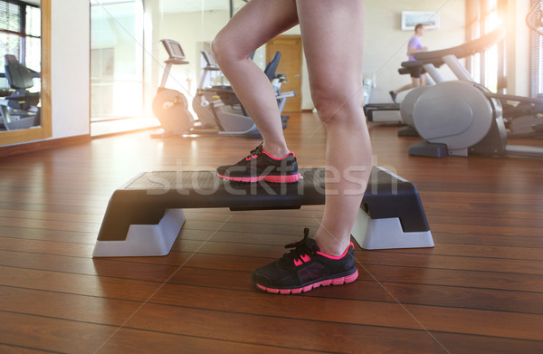 Young woman doing step aerobics while in health club Stock photo © dashapetrenko