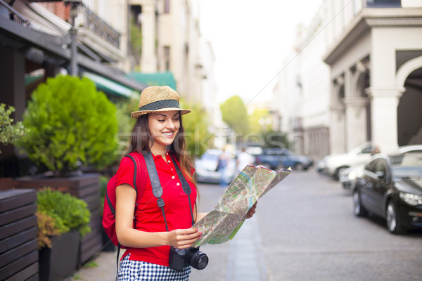 Portrait of a beautiful female tourist searching a place on the  Stock photo © dashapetrenko