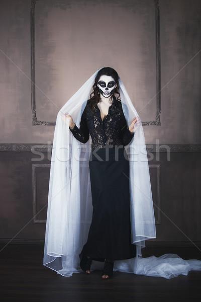 Beautiful woman painted as skeleton. Halloween theme Stock photo © dashapetrenko