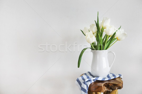 Tulips bouquet in white vase on wooden rustic chair  Stock photo © dashapetrenko