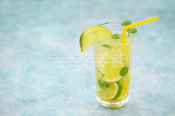 Glasses of homemade lemonade on a rustic wooden background Stock photo © dashapetrenko