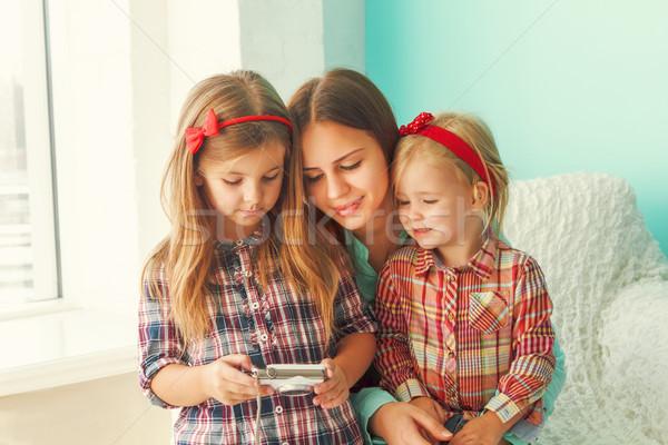 Three sisters looking at camera Stock photo © dashapetrenko