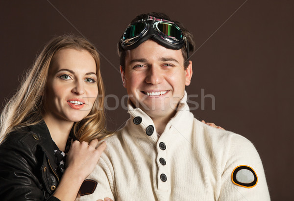 Young couple in retro style clothes over brown background Stock photo © dashapetrenko